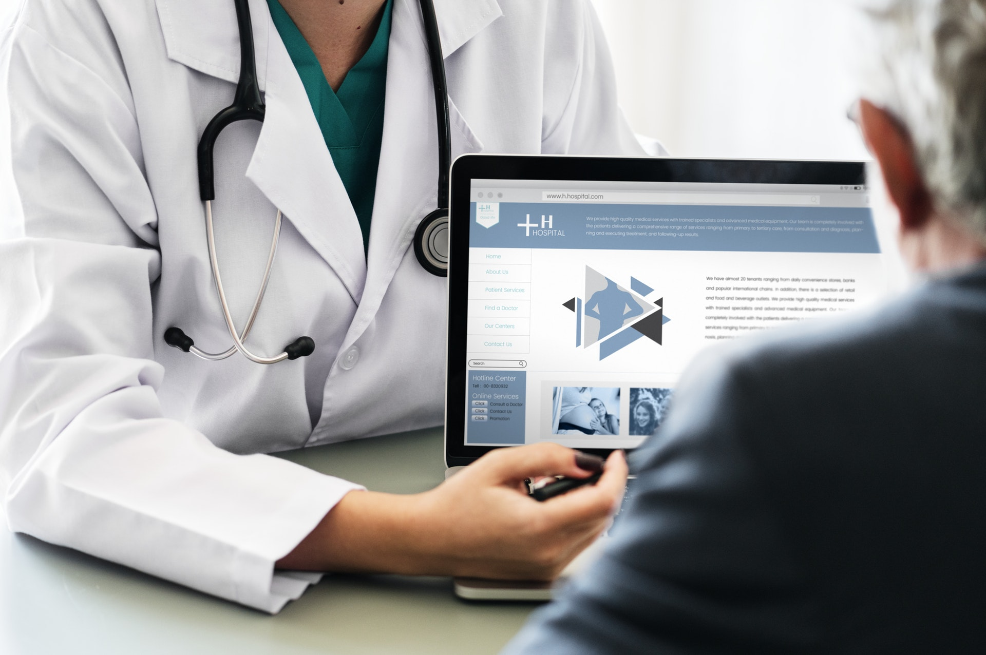 Doctor pointing at computer